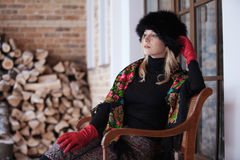 Winter portrait of blonde woman in colorful scarf Royalty Free Stock Images