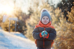 Winter portrait of a boy in the snow in sunny day. Royalty Free Stock Images