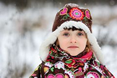 Winter portrait of child girl in snowsuit Stock Image
