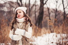 Winter portrait of child girl on the walk in snowy forest Royalty Free Stock Photography