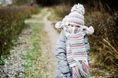 Winter portrait of child girl in warm clothes Royalty Free Stock Photo