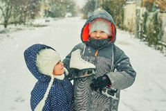 Winter fun in the fresh air .Funny children for a walk royalty free stock images