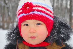 Winter portrait of a cute child. Portrait of a cute child outside in wintertime stock photo