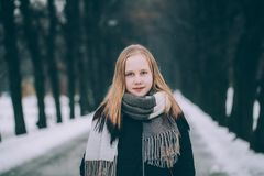 Winter Portrait of Cute Blonde Girl Outdoors royalty free stock photo