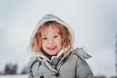 Winter portrait of cute happy child girl in grey coat Royalty Free Stock Photos
