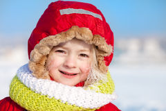 Winter portrait of a cute little girl with white frost on her ha Royalty Free Stock Photo