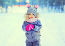 Winter portrait funny smiling child in snowy Royalty Free Stock Image