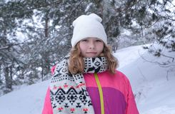 Winter portrait in fur-trees. Winter portrait in a Christmas tree girl snow forest stock photography