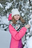 Winter portrait in fur-trees. Winter portrait in a Christmas tree girl snow forest stock photo