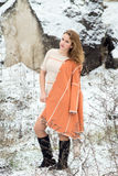 Winter portrait of the girl. A bright orange coat Stock Photography