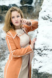 Winter portrait of the girl. A bright orange coat Royalty Free Stock Photography