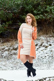 Winter portrait of the girl. A bright orange coat Royalty Free Stock Photo
