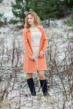 Winter portrait of the girl. A bright orange coat Royalty Free Stock Image