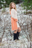 Winter portrait of the girl. A bright orange coat Royalty Free Stock Photos