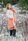 Winter portrait of the girl. A bright orange coat Royalty Free Stock Images
