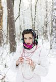 Winter portrait of a girl. C decoration Stock Photos