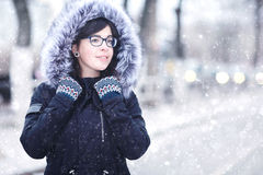 Winter portrait of a girl in the city Royalty Free Stock Images