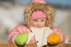 Winter portrait of a girl with Down syndrome. Winter portrait of a girl with  Down syndrome Stock Photo