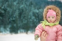 Winter portrait of a girl with  Down syndrome. Winter portrait of a girl with Down syndrome Royalty Free Stock Photos