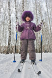 Winter portrait of the girl of four years on skis Royalty Free Stock Photo