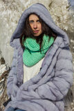 Winter portrait of a girl in a fur coat Stock Images