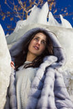 Winter portrait of a girl in a fur coat Stock Photography