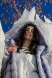 Winter portrait of a girl in a fur coat Royalty Free Stock Photos