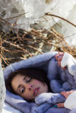 Winter portrait of a girl in a fur coat Stock Image