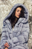 Winter portrait of a girl in a fur coat Royalty Free Stock Photo