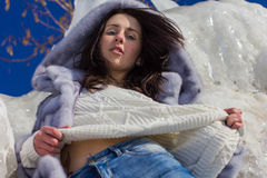 Winter portrait of a girl in a fur coat Royalty Free Stock Photography