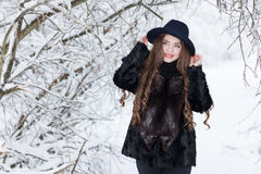 Winter portrait of a girl. In a hat Royalty Free Stock Photos