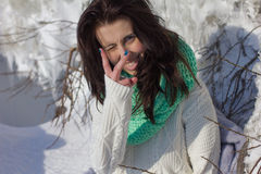 Winter portrait of a girl near ice Stock Images