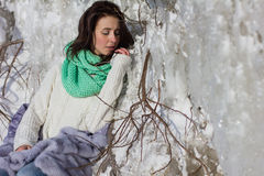 Winter portrait of a girl near ice Royalty Free Stock Image