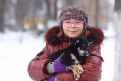 Winter portrait of a girl and puppy Royalty Free Stock Photography