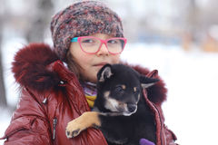 Winter portrait of a girl and puppy Stock Photography
