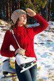 Winter portrait of a girl with skates Royalty Free Stock Photography