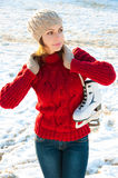 Winter portrait of a girl with skates Royalty Free Stock Images