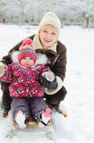 Winter portrait of grandmother and granddaughter Royalty Free Stock Image