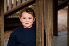 Winter portrait of happy boy on playground Stock Image