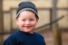 Winter portrait of happy boy on playground Stock Photography