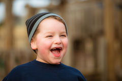 Winter portrait of happy boy on playground Royalty Free Stock Image