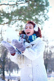 Winter portrait of happy girl throwing snow in park outdoors Stock Images