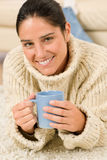 Winter portrait of happy woman with coffee Royalty Free Stock Images