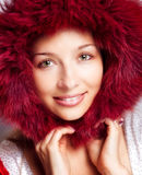 Winter portrait of happy woman with fur hood. Winter portrait of happy woman with fur cozy hood royalty free stock photography