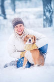 Winter portrait happy woman with her pet Royalty Free Stock Images