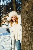Winter portrait of happy woman with snowball outdoor royalty free stock photo