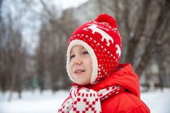 Winter portrait of kid boy in colorful clothes royalty free stock photo