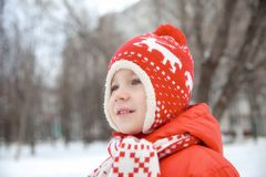 Winter portrait of kid boy in colorful clothes royalty free stock photography