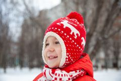Winter portrait of kid boy in colorful clothes stock photos