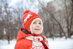 Winter portrait of kid boy in colorful clothes stock photo